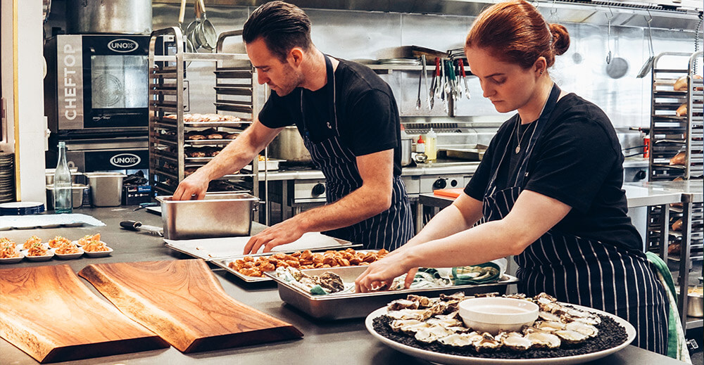 Chefs preparing food platters
