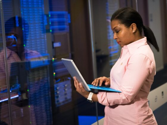 Lady with a laptop by a server